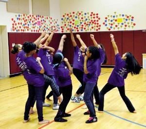 Students at New Haven's Truman School participate in Pilobolus' MOVIN' program. Photo by Peter Casolino.