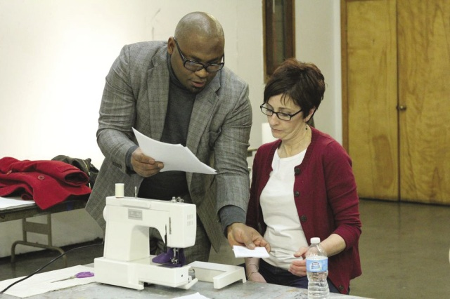 Philip Alexander gives pointers to a student during a sewing class at Creative Arts Workshop. Photo by Katherine Spencer Carey.