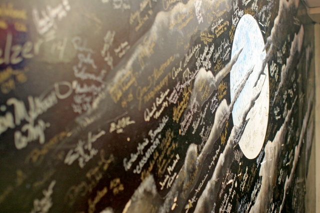 Signatures of Cats cast members on a backstage mural. Photo by Amanda May.