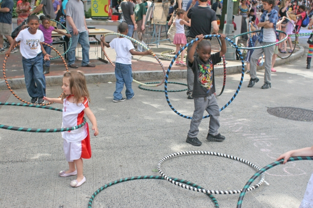 Children enjoy hula hooping along Audubon Street during Audubon Arts on the Edge 2013. Amanda May photo.